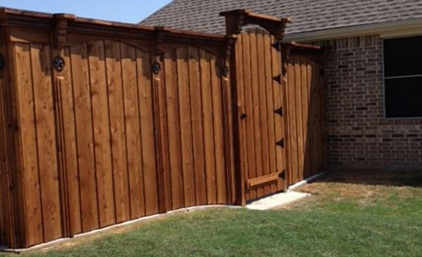 custom cedar fence with high gate black hinges