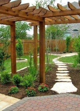 Cedar pergola behind privacy fence